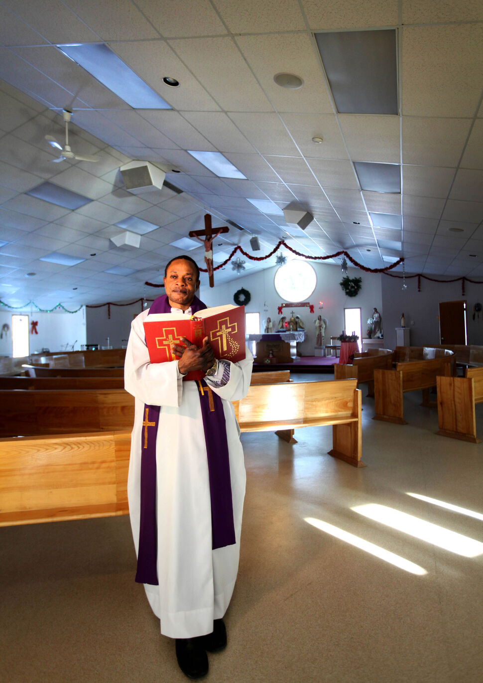 Parish Priest Malacy Ekezie of St. Alexander Parish church in Sagkeeng First Nation. 