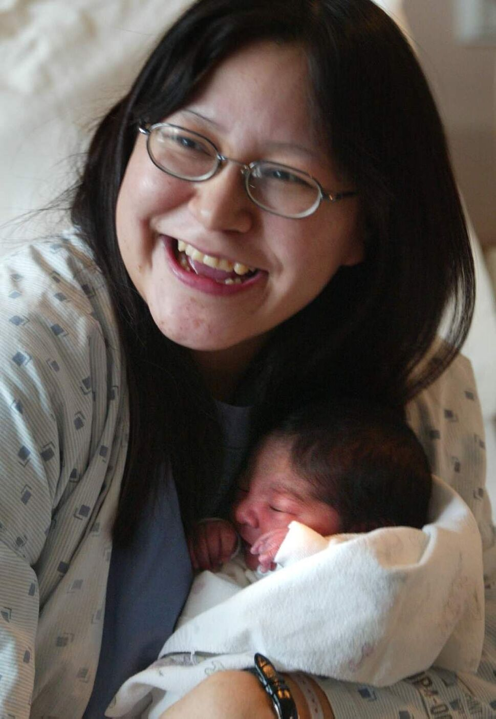 Medivac 'stork' brings New Year's baby Kristen Monias was flown 600 km to give birth to her fifth child, Chanel, at St. Boniface hospital yesterday. (Wayne Glowacki / Winnipeg Free Press)