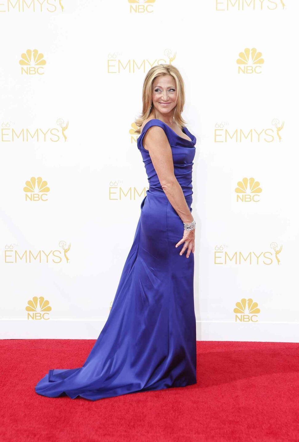 Edie Falco (Nurse Jackie) arrives for the 66th Annual Primetime Emmy Awards at Nokia Theatre at L.A. Live in Los Angeles Monday. (Tribune Media MCT)