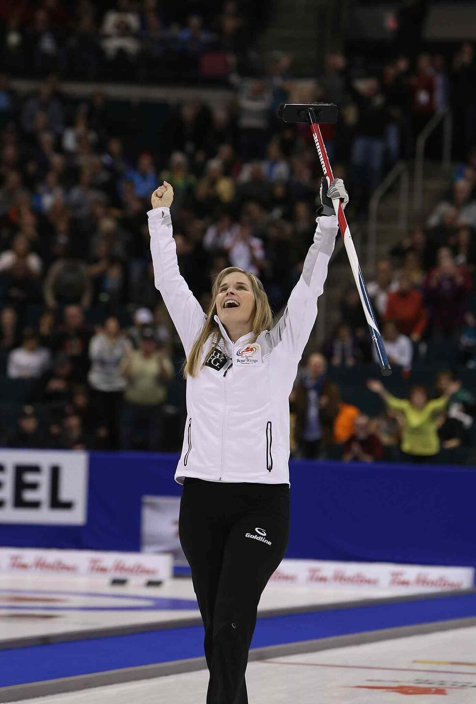 Jennifer Jones celebrates after defeating Sherry Middaugh in the women's final of Roar of the Rings curling at the MTS Centre Saturday. (Jason Halstead / Winnipeg Free Press)
