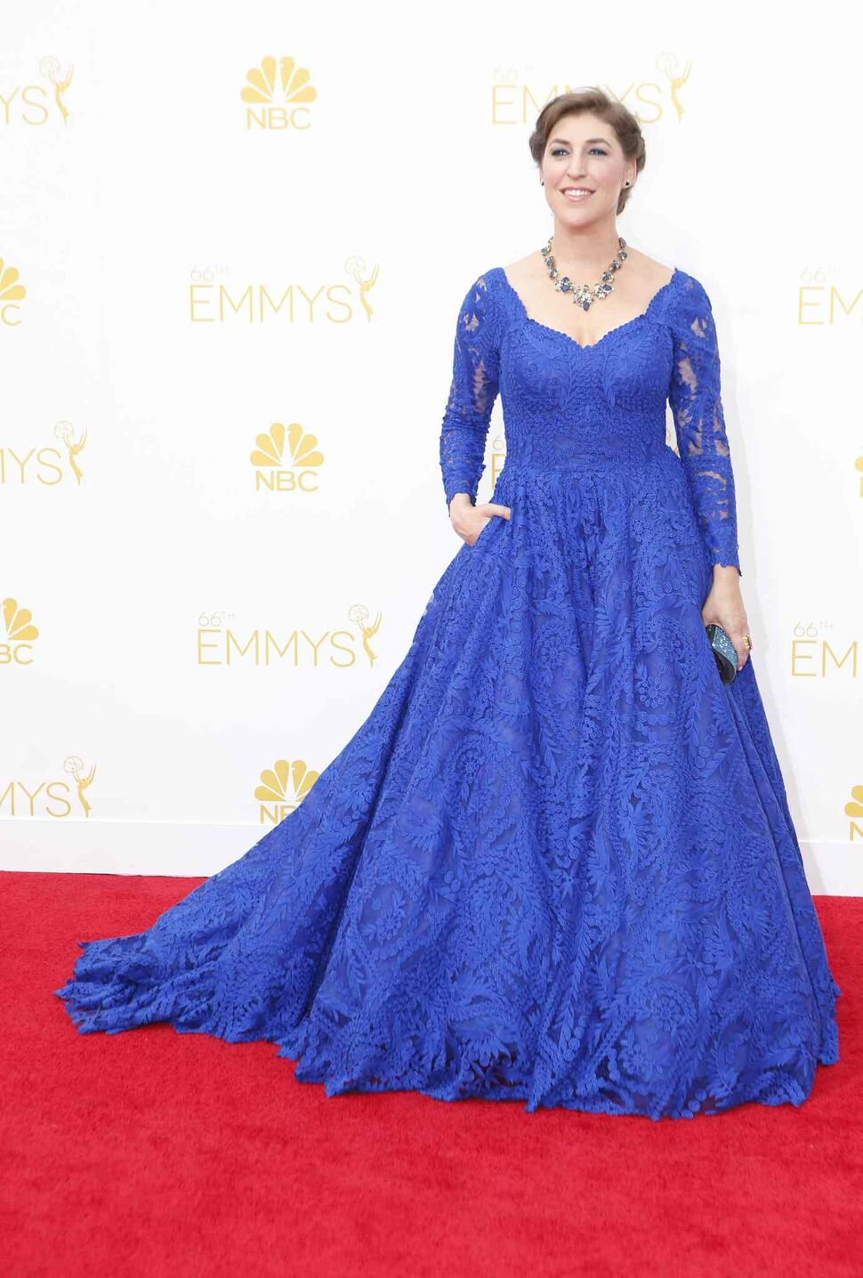 Mayim Bialik (The Big Bang Theory) arrives for the 66th Annual Primetime Emmy Awards at Nokia Theatre at L.A. Live in Los Angeles Monday. (Tribune Media MCT)