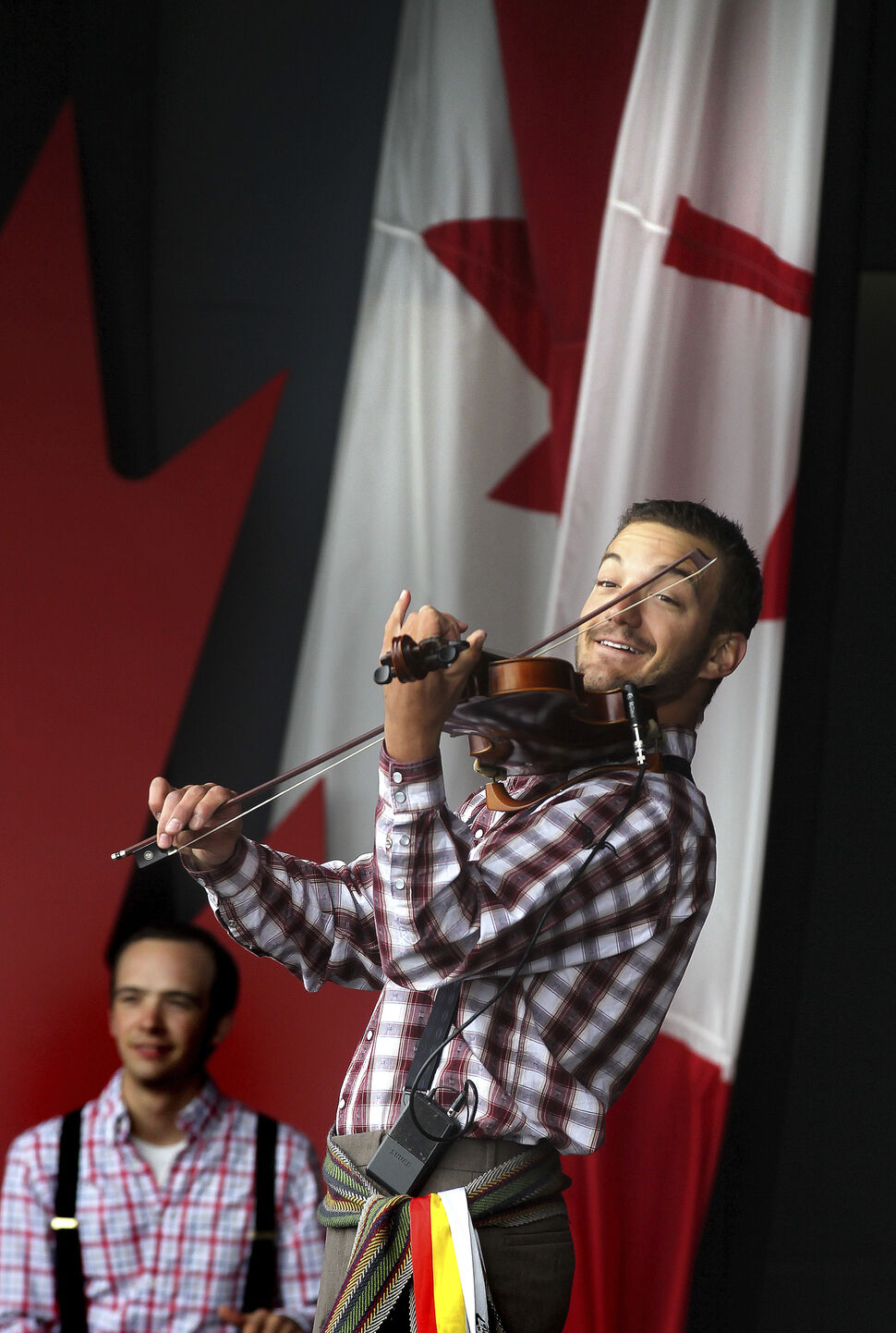 Nic Messner and the Folk Group Ca Claque! warm up the crowd at the Lyric stage at Assiniboine Park for a cool Canada Day celebration. July 1, 2014  (Phil Hossack / Winnipeg Free Press)