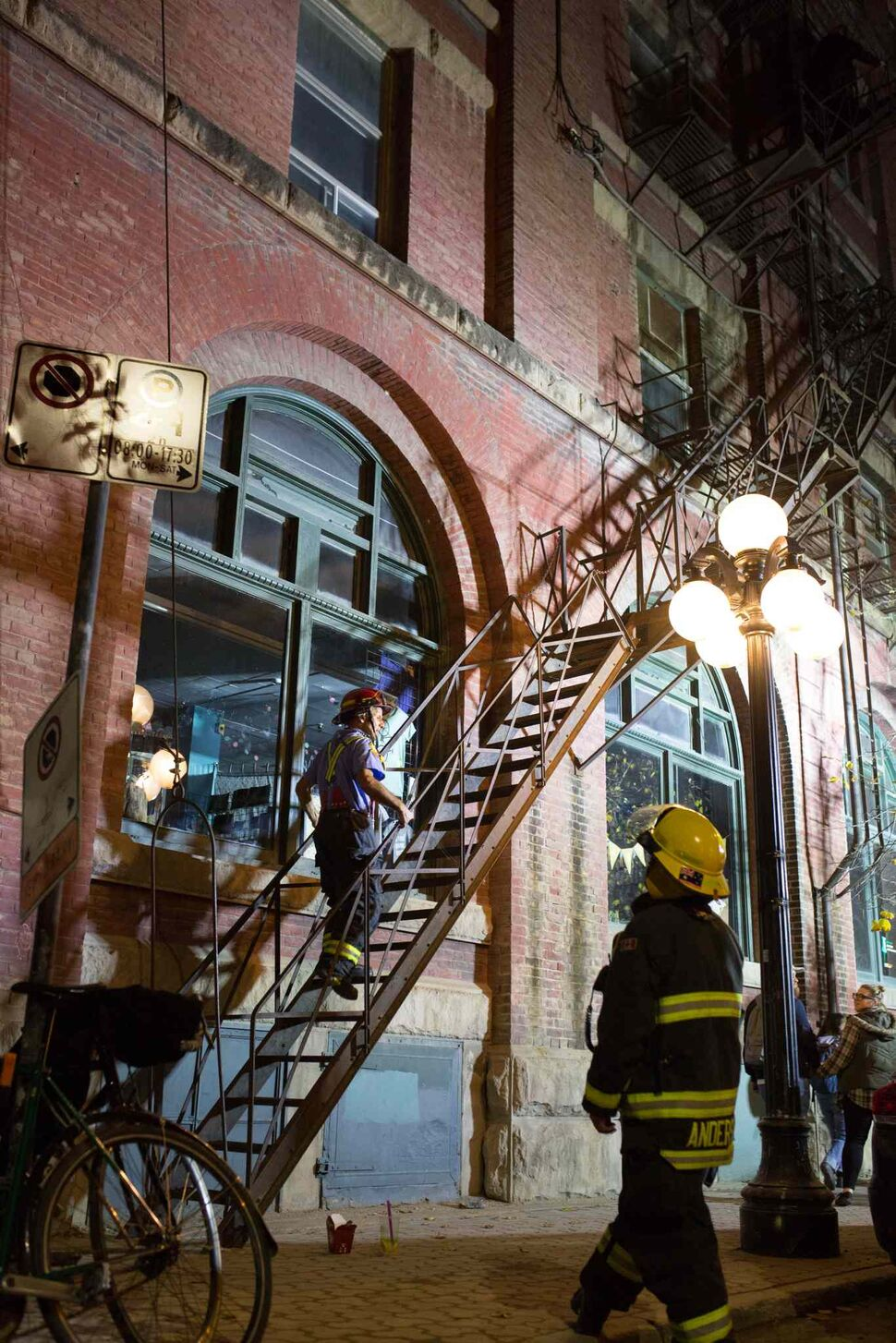 Winnipeg Firefighters respond to an incident where a group of people climbed a fire escape along Princess St.