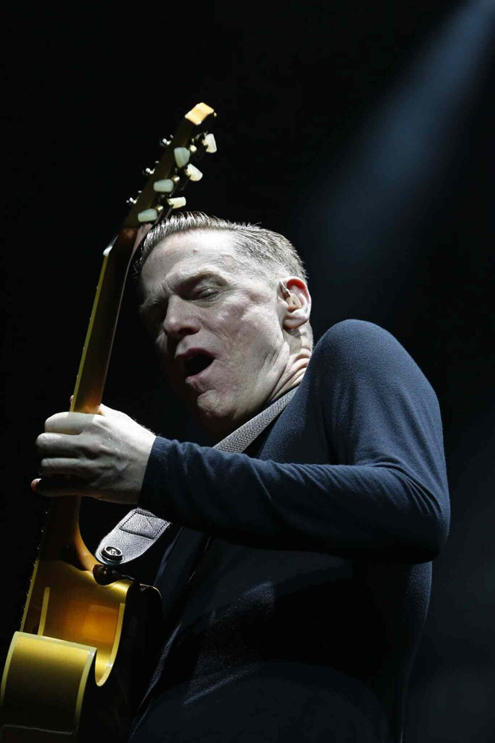 Bryan Adams rocks out on his acoustic guitar at the MTS Centre Tuesday.  (John Woods / Winnipeg Free Press)
