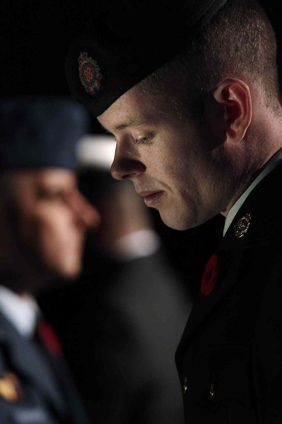 A soldier reflects during the Remembrance Day service at the RBC Convention Centre Winnipeg. (JOHN WOODS / THE CANADIAN PRESS)