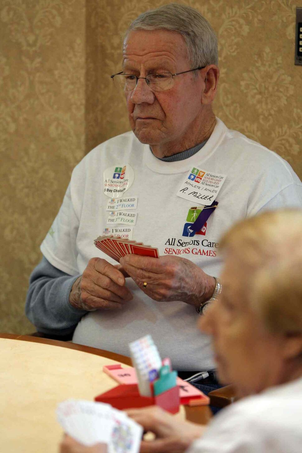 Bob Miller concentrates while playing cards during the All Senior Care Senior Games 2014 at Shaftesbury Park Retirement Residence.  (Boris Minkevich / Winnipeg Free Press)
