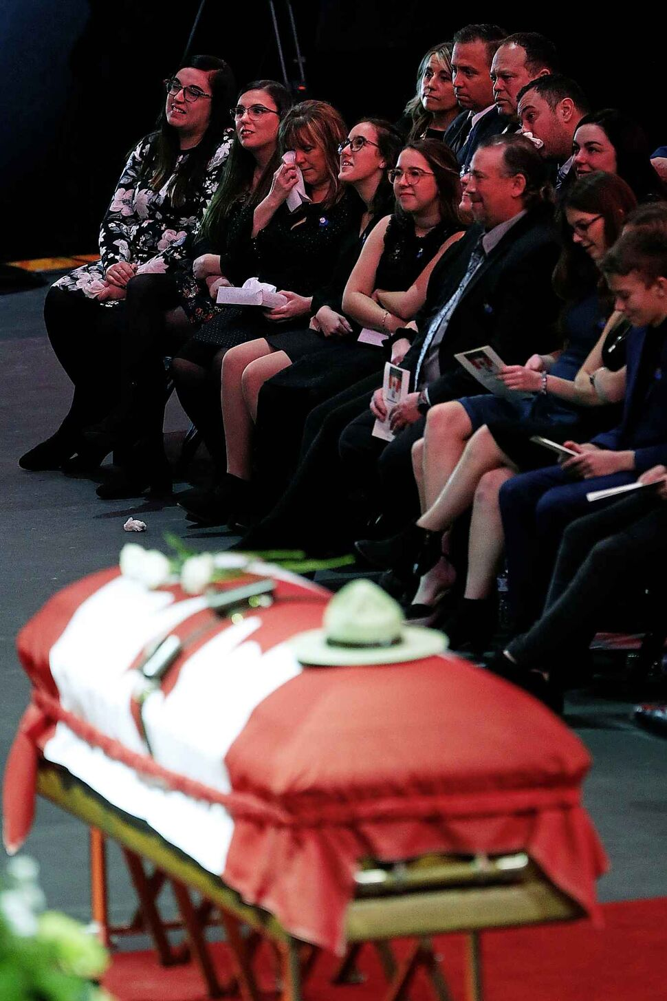 Family members listen to the eulogy. (John Woods / The Canadian Press)