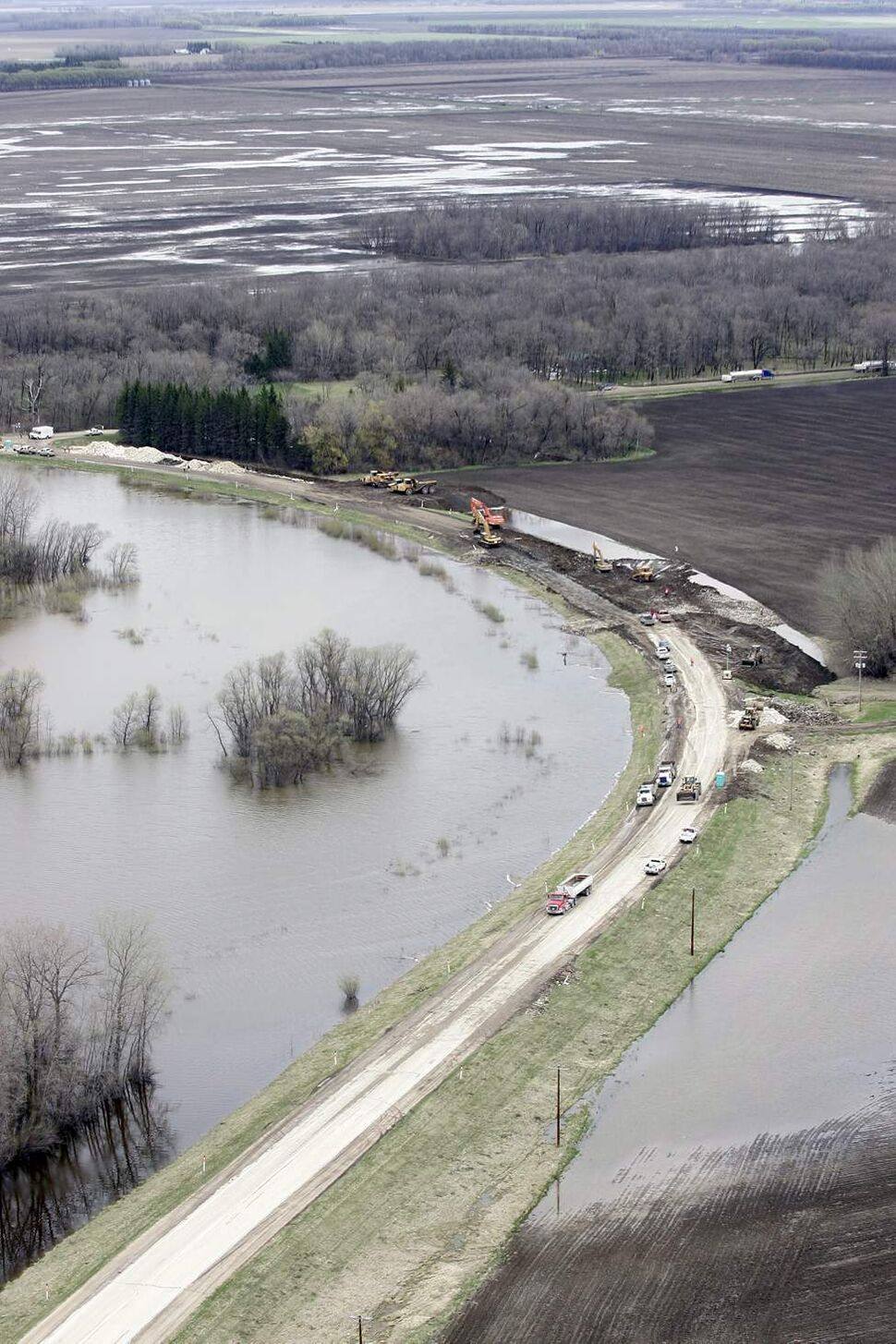 An aerial photo showns the Assiniboine River and the Hoop and Holler Bend, where the province plans to create a controlled breach in Manitoba Wednesday. Prime Minister Stephen Harper toured the Brandon flood area Wednesday. May 11, 2011 (THE CANADIAN PRESS/John Woods)