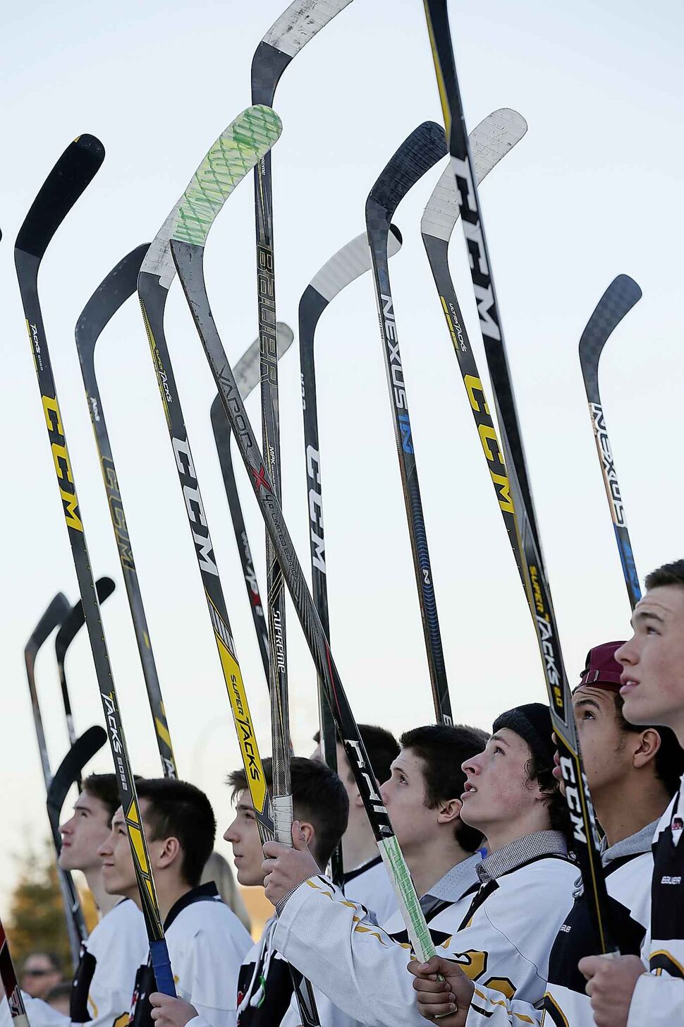 JOHN WOODS / WINNIPEG FREE PRESS</p><p>April 16 — Players raise their sticks at a Manitoba Hockey vigil for the Humboldt Broncos at My Church in Winnipeg.</p>