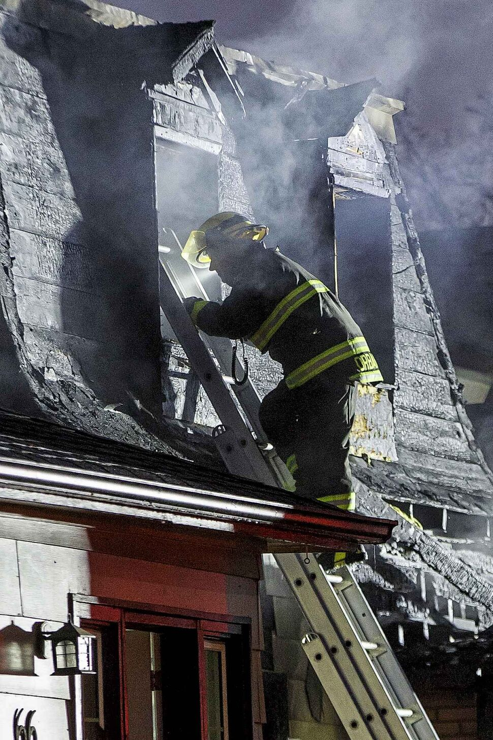 MIKE DEAL / WINNIPEG FREE PRESS</p><p>October 26 — Winnipeg Fire Paramedic Service personnel work at putting out a house fire at 68 Prince Edward St. in the Point Douglas neighbourhood where two people are missing and may have died in the fire early Friday morning.</p>