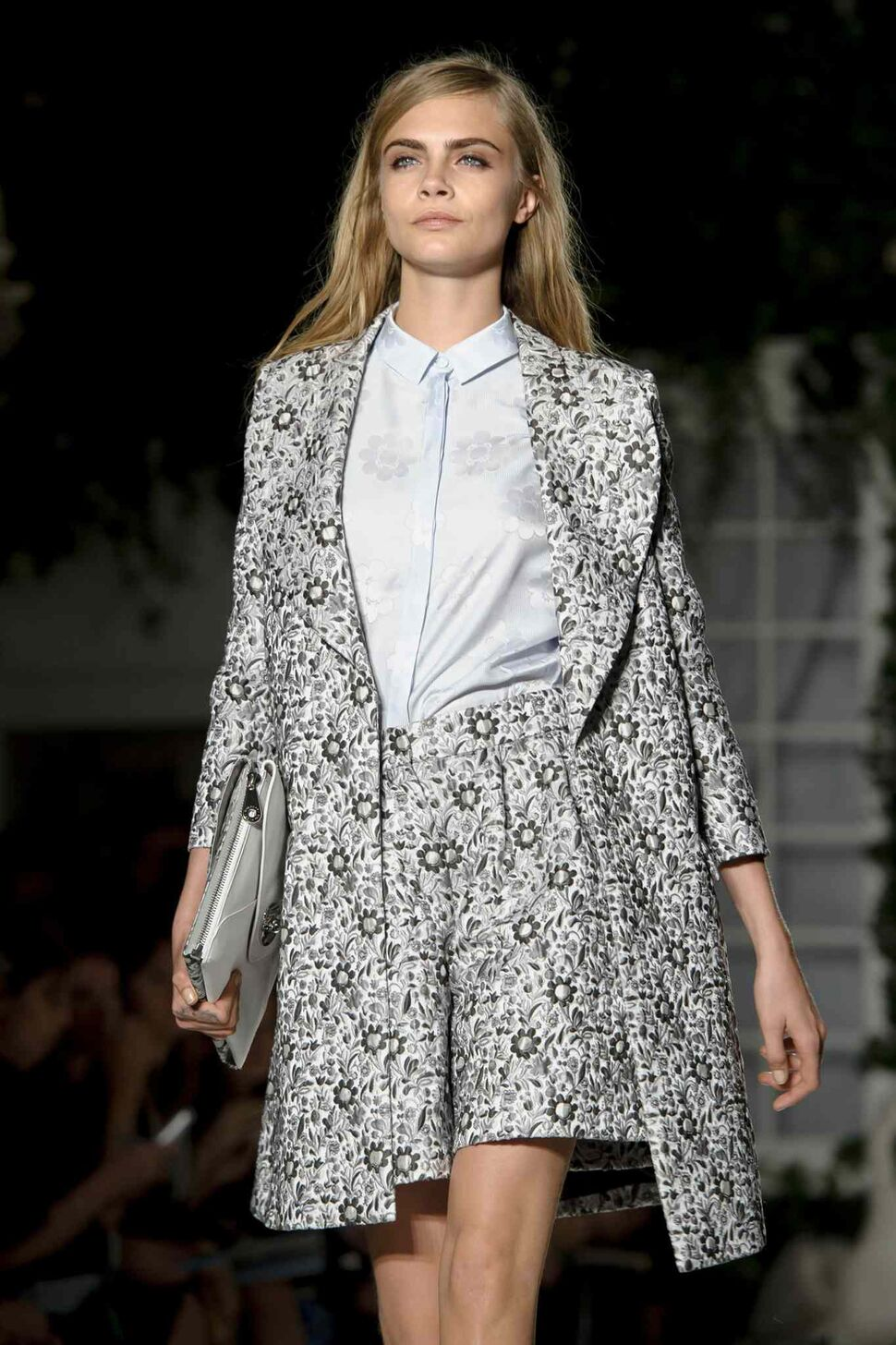 British model Cara Delevingne wears a design created by Mulberry during London Fashion Week Spring/Summer 2014, at Claridges Hotel in central London, Sunday, Sept. 15, 2013. (Jonathan Short / The Associated Press)