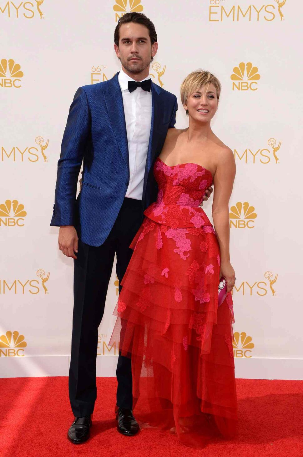 Ryan Sweeting, left, and Kaley Cuoco-Sweeting (The Big Bang Theory) arrive at the 66th Primetime Emmy Awards at the Nokia Theatre L.A. Live Monday in Los Angeles.  (Evan Agostini/Invision for the Television Academy/AP Images)