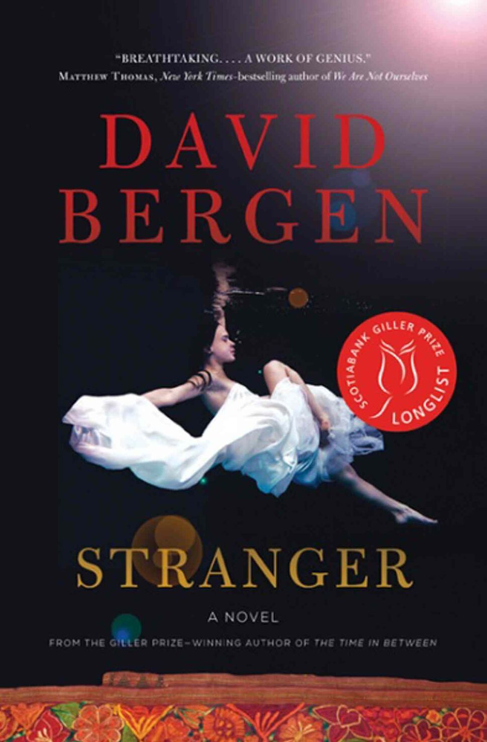 <h3>Stranger</h3> <br/> By David Bergen <br/> <strong>David Bergen's Stranger is set in Guatemala and an ominous, militarized near-future America. This excellent novel can be read as a prophetic denunciation of the ills that follow systemic classism and racism south of the border, but it does not sacrifice story to a political agenda.</strong> <br/> — Julienne Isaacs