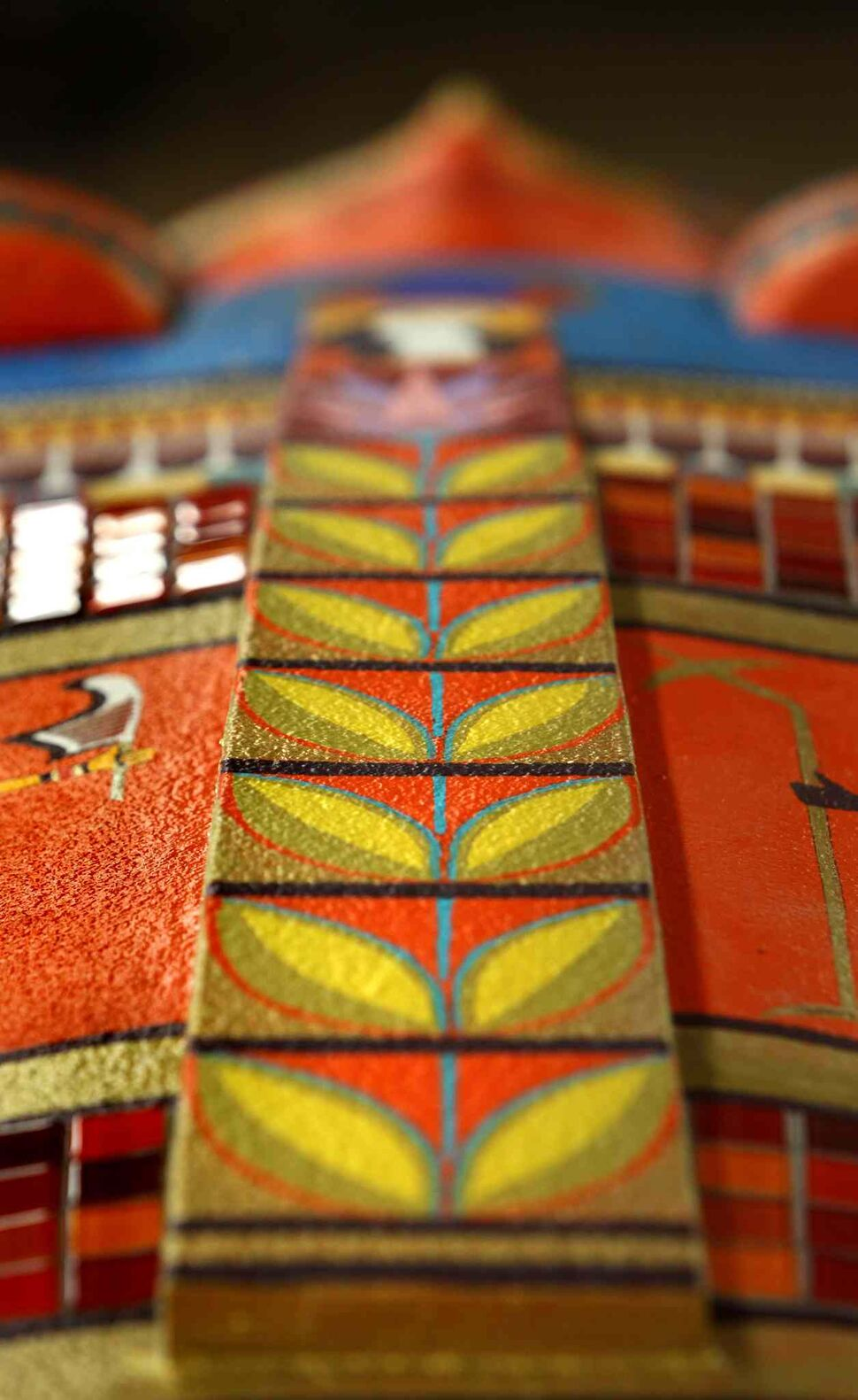 Gold, red, and blue add contrast to the bright orange figure.  (Ruth Bonneville / Winnipeg Free Press)