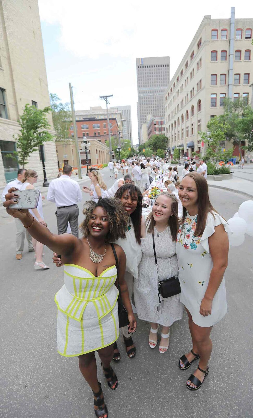 L-R: Lidet Getachew, Julia Dacosta, Luba Michno and Janelle Landry snap a photo at the north end of the Table for 1200 More dinner.</p> (Jason Halstead)
