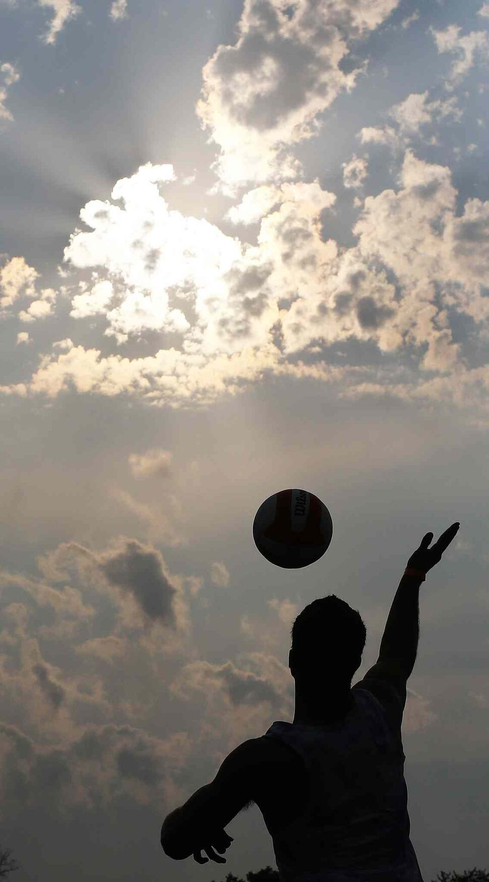 A member of Back That Pass Up hits the ball during the Super-Spike volleyball tournament at Maple Grove Rugby Park, Friday, July 18, 2014.  (TREVOR HAGAN/WINNIPEG FREE PRESS)