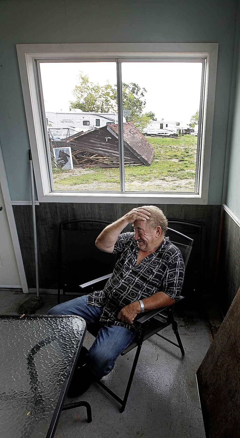 PHIL HOSSACK / WINNIPEG FREE PRESS</p><p>August 7 — Sitting in the Margaret Bruce Beach office and campground store with the wreckage of a camper over his right shoulder, Jimmy Bruce laughs at himself in hindsight for staying in the structure as a tornado destroyed the family campground Friday.</p>