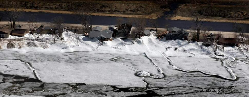 Ice pushes up against homes in the community of Ochre Beach southeast of Dauphin. May 13, 2013 - (Phil Hossack / Winnipeg Free Press)