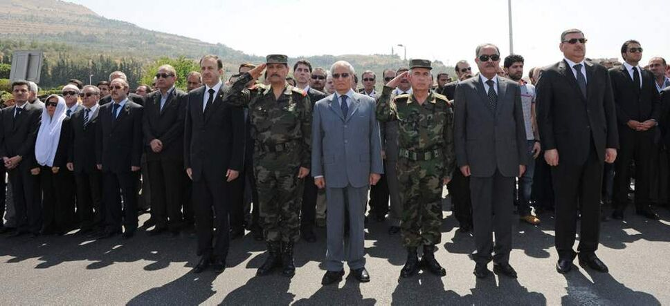 In this photo released by the Syrian official news agency SANA, new Syrian defense minister Fahd Jassem al-Freij, second left, and Farouk Sharaa, Bashar Assad's vice president, centre, attend the funeral processions of members of President Assad's inner circle, who were killed on Wednesday by a bomb, in Damascus. A bombing in Damascus claimed by Syrian rebels Wednesday killed key figures in President Bashar Assad's inner circle. (AP Photo/SANA) (CP)