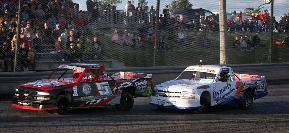 Racers Glenn Manning (left) and Jamie Vernaus butt trucks in front of an appreciative crowd.