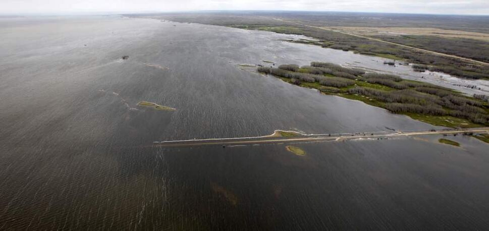 The three Shoal Lakes have essentially merged into one large lake just east of Lake Manitoba overflowing its banks and flooding surrounding roads and farmlands. May 12, 2011. (Mike Deal / Winnipeg Free Press)