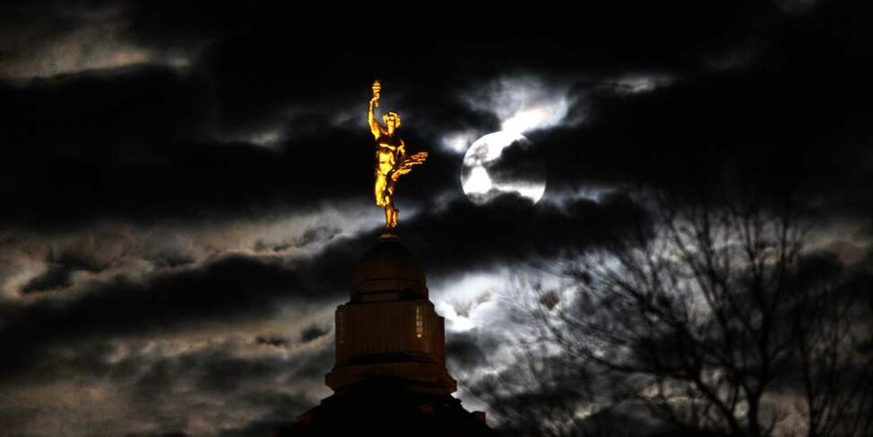A supermoon brightens the Golden Boy on top of Manitoba's Legislative Building Saturday evening.  The supermoon is the largest full moon of the year and occurs when the it coincides with the moon's closest pass to the Earth. 