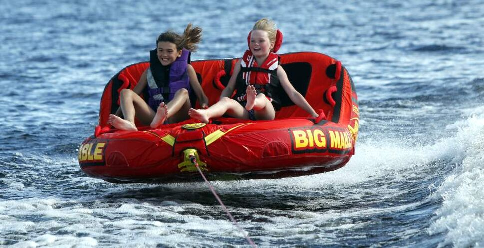 Long Weekend fun on Longbow Lake, just east of Kenora, Ontario. A pair of 9 year olds, Abby Dent and Nori Sigvaldason, catch some air while tubing. July 2, 2011