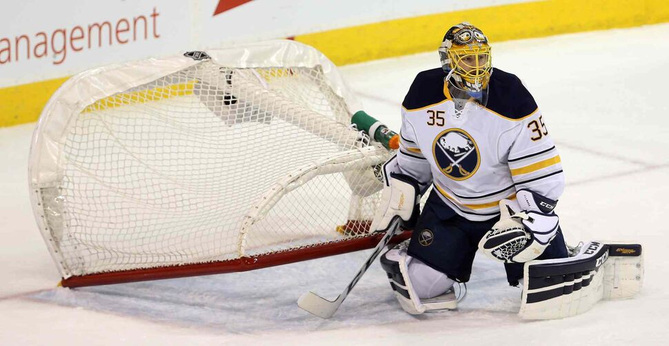 Buffalo Sabres' goaltender Linus Ullmark (35) sits under his net after it was pushed over during the first period. (Trevor Hagan / The Canadian Press)