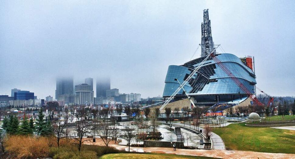 Fog hangs over downtown Winnipeg and the Canadian Museum for Human Rights early in the morning. Saturday, April 14, 2012. (MIKE DEAL / WINNIPEG FREE PRESS)