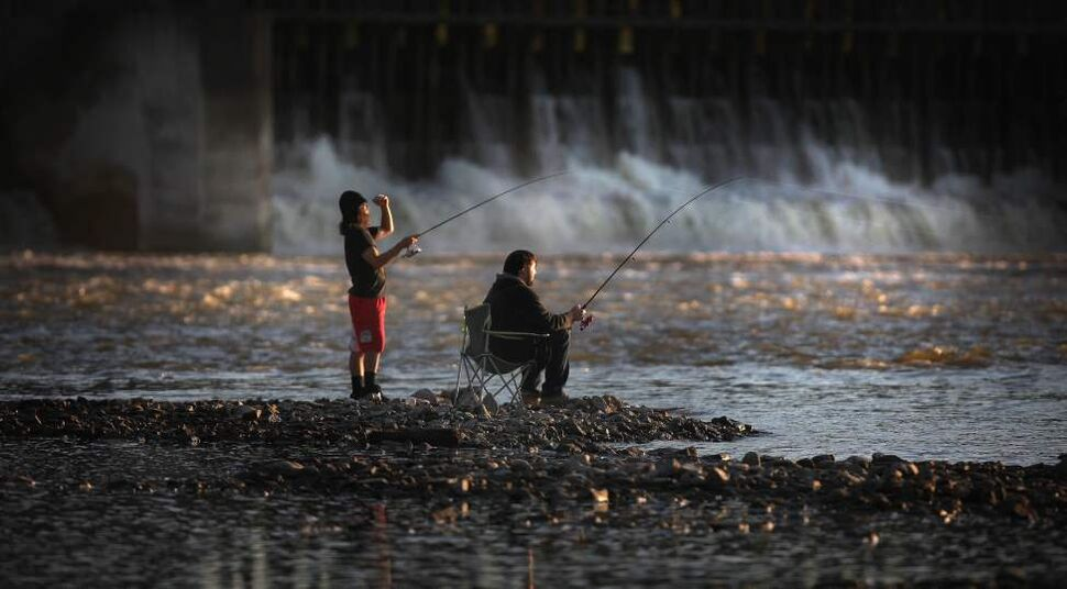 Fall fishers Charlie McConaghy (left) and Kevin Podolchuk bask in the evening glow at the foot of the Red River Control Structure and Locks in Lockport.  September 24, 2013 (Phil Hossack / Winipeg Free Press)