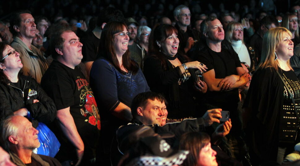 Fans enjoying the blast from the past as ZZ Top takes the stage.  (BORIS MINKEVICH / WINNIPEG FREE PRESS )