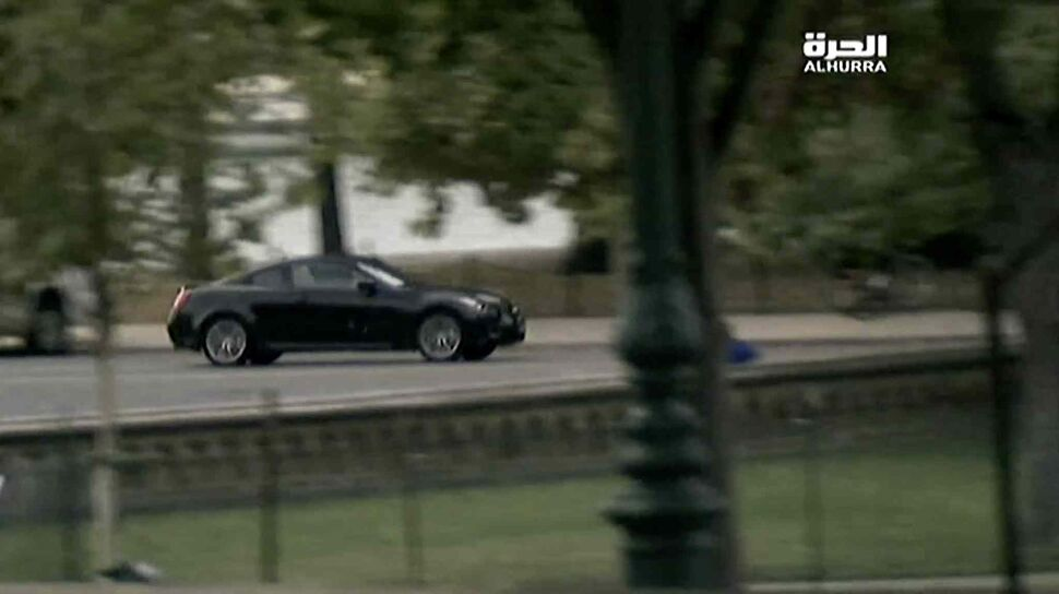 In a still image from video provided by Alhurra Television, a black Infiniti speeds near the U.S. Capitol in Washington on Thursday. (Alhurra Television / The Associated Press)