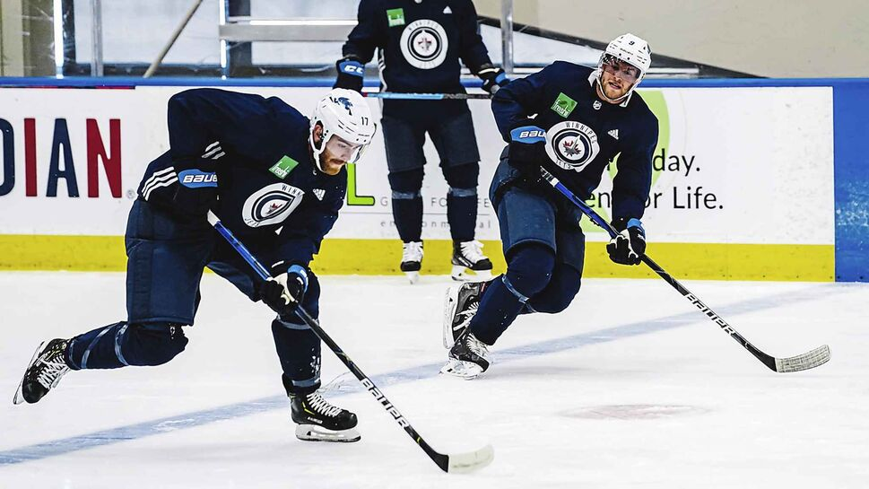 Adam Lowry (17) and Andrew Copp (9) at a Winnipeg Jets practice in Edmonton on Tuesday. (TYLER ESQUIVEL / WINNIPEG JETS)