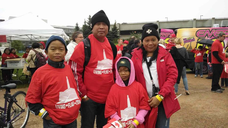 The Salarzons moved to Canada from the Philippines on June 10, and wanted to show their children how Canada celebrates itself. (Oliver Sachgau / Winnipeg Free Press)