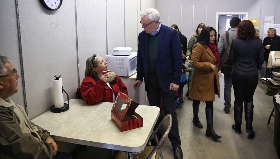 NDP Leader Greg Selinger chats with supporter Marilyn Rosaasen during an election stop at St. James MLA Deanne Crothers campaign office.