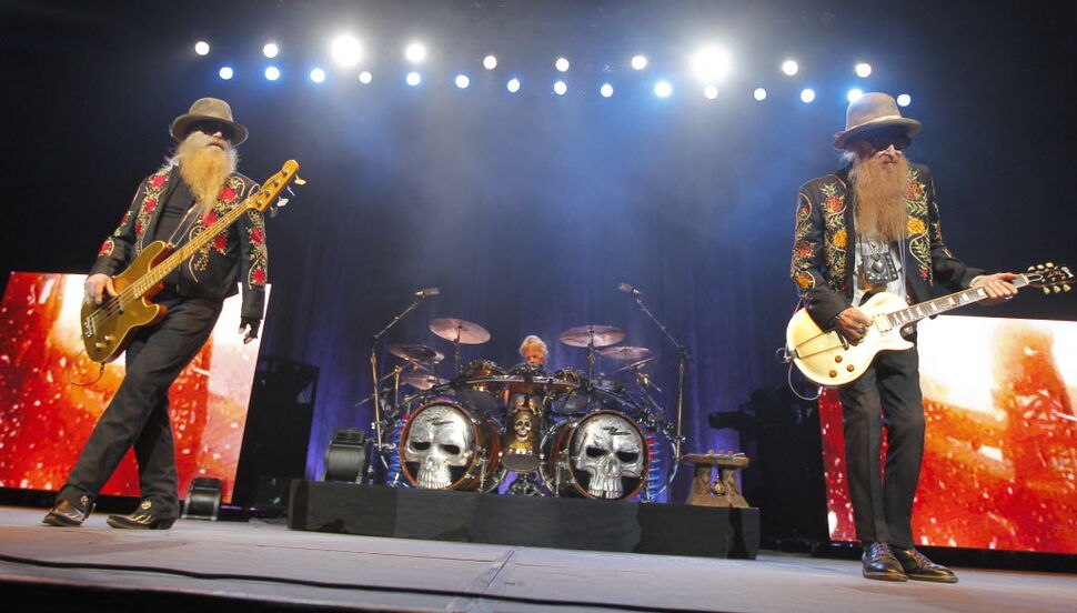 ZZ Top performing at MTS Centre in Winnipeg. from left to right: Dusty Hill (bass), Frank Beard (drumming), and Billy Gibbons (guitar).  (BORIS MINKEVICH / WINNIPEG FREE PRESS )