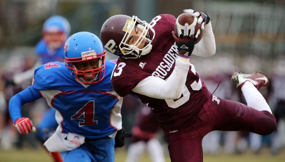 St.Paul's Crusaders' Salim Belrhazi (83) makes a difficult catch in front of Churchill Bulldogs' Lawi Milligita (4) during their High School Football game at St.Paul's High School, Thursday, October 25, 2012. (TREVOR HAGAN/WINNIPEG FREE PRESS)