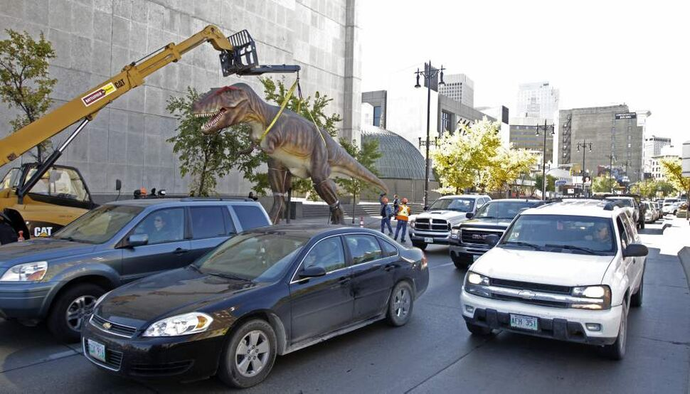 A life-sized replica of a T-Rex dinosaur is moved to the front of the Manitoba Museum for the launch of the museum's new exhibition Dinosaurs Unearthed.  Wednesday, September 26, 2012. (MIKE DEAL / WINNIPEG FREE PRESS)