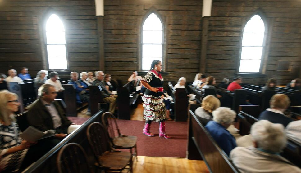 Traditional Jingle dancer Sarah Thomas performs the healing dance at the service.</p>