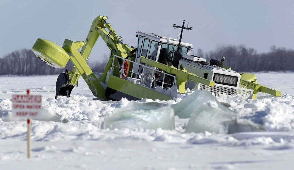 Three Amphibex ice-breaking machines were out on the Red River north of Selkirk earlier this month as part of the 2014 ice jam mitigation program, which apparently wasn't a sign of early spring. (Wayne Glowacki / Winnipeg Free Press files)