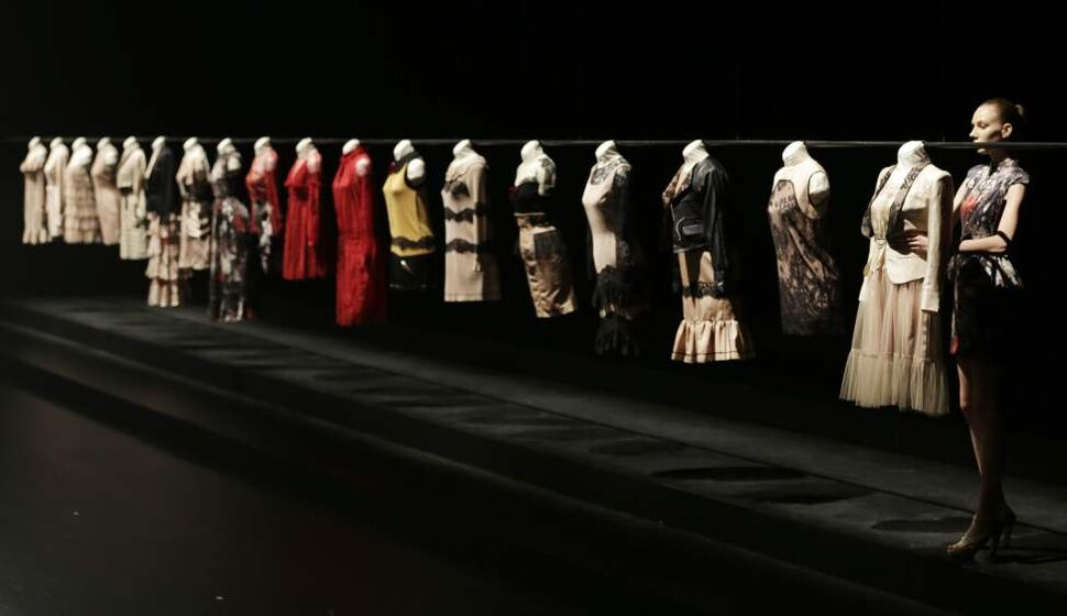 A model displays creations by Japanese designer Motonari One during the 2013 spring/summer collection at Tokyo Fashion Week in Tokyo, Thursday, Oct. 18, 2012. (AP Photo/Koji Sasahara)
