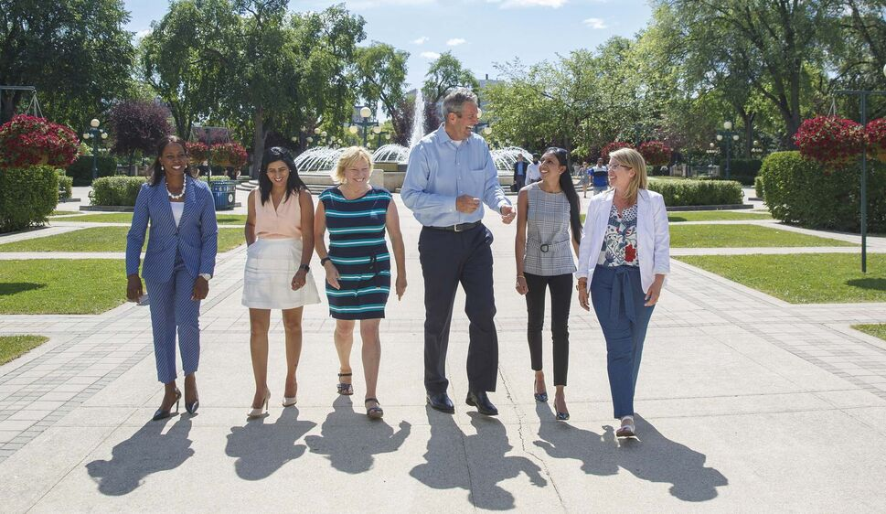 Brian Pallister, centre, with five nominees for MLA (from left); Audrey Gordon (Southdale), Jasmine Brar (Burrows), Susan Boulter (River Heights), Aman Sandhu (The Maples), Nancy Cooke (Fort Garry). (MIKE DEAL / WINNIPEG FREE PRESS)