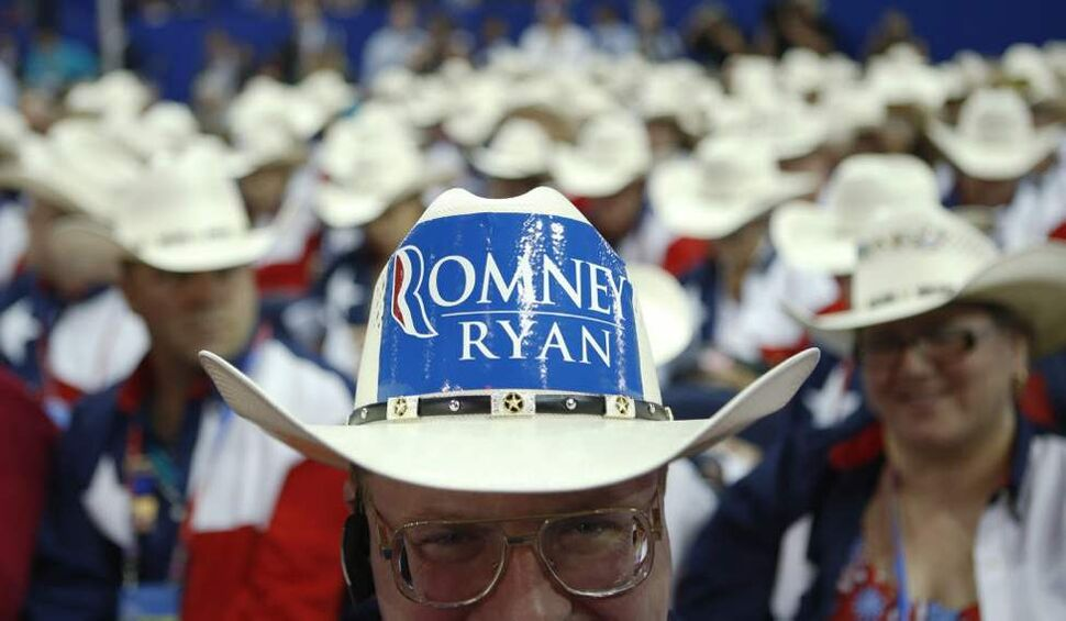 Texas delegate Clint Moore and the rest of Texas delegates fashion their cowboy hats at the Republican National Convention in Tampa, Fla. (AP Photo/Jae C. Hong)
