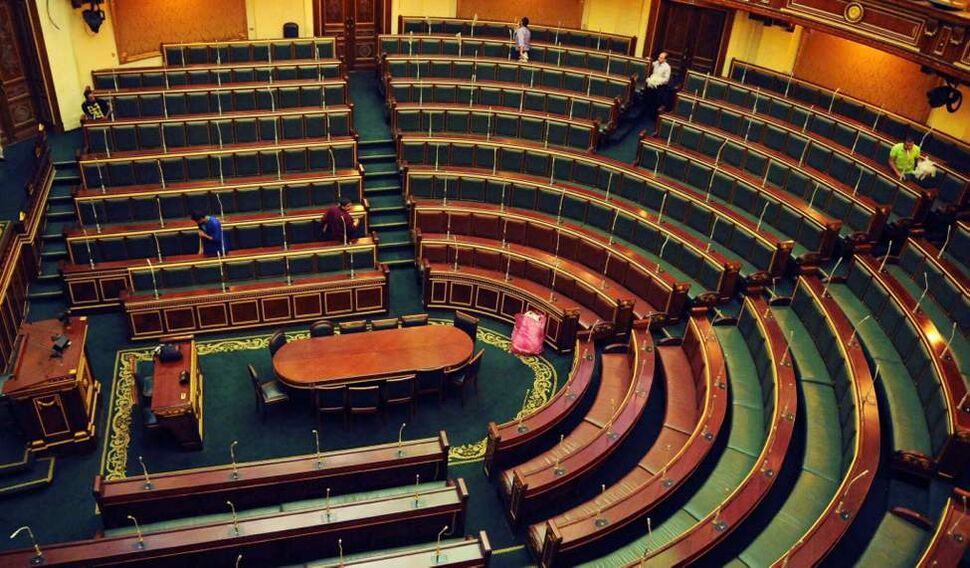 Workers clean inside the Egyptian parliament in Cairo. The speaker of Egypt's Islamist-dominated parliament called for the legislature to meet this week, raising the stakes in a tense standoff with the powerful military which backed a court ruling to dissolve the chamber. (AP Photo/Mohammed Asad)