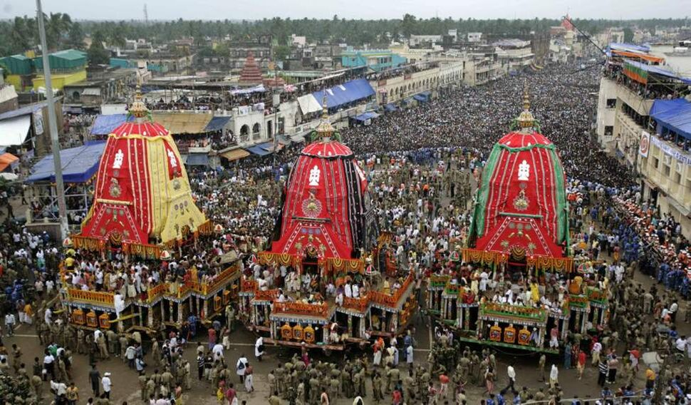"Devotees throng around the chariots as they wait to pull them during the annual Hindu festival ""Rath Yatra,"" or Chariot procession, at Puri, Orissa state, India. The annual procession of the three idols of lord Jagannath, Balabhadra and Subhadra is taken out in a grand procession in specially made chariots called raths, which are pulled by thousands of devotees. (AP Photo/Biswaranjan Rout)"