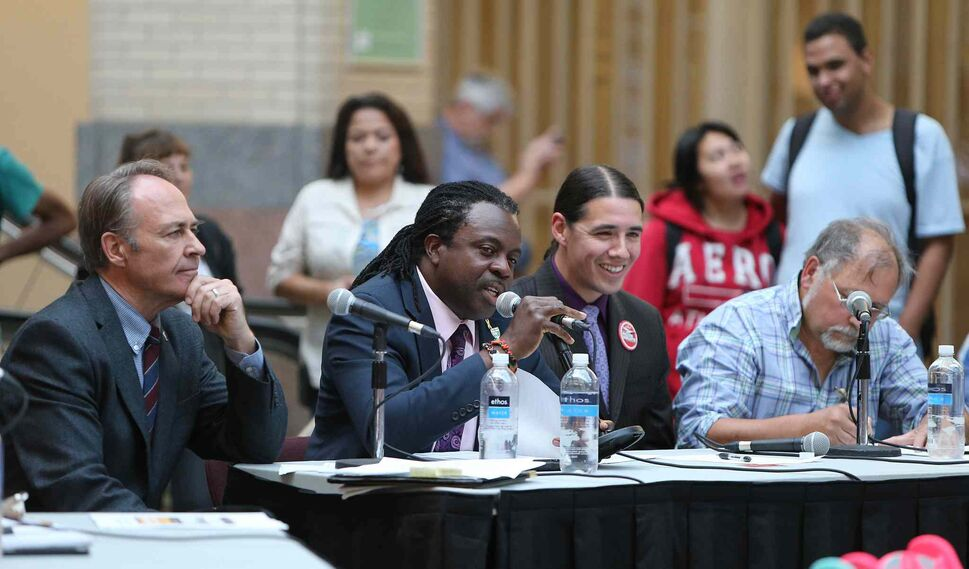 Federal election candidates (from left) Pat Martin (New Democratic Party), Don Woodstock (Green Party), Robert-Falcon Ouellette (Liberal Party) and Darrell Rankin (Communist Party) discuss their platforms at a forum at Portage Place Shopping Centre on Thursday.  (Jason Halstead / Winnipeg Free Press)