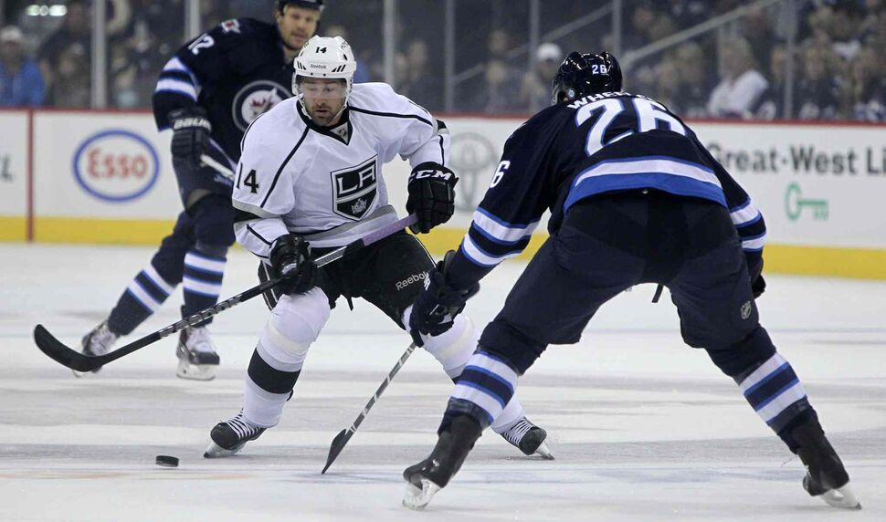 Winnipeg Jets' Blake Wheeler (26) takes on Los Angeles Kings' Justin Williams (14) in the first period. (MIKE DEAL / WINNIPEG FREE PRESS)