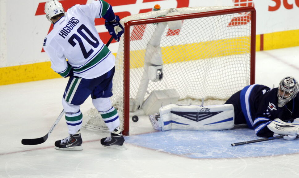 Chris Higgins (20) scores the only shootout goal for the Canucks to win the game.   (BORIS MINKEVICH / WINNIPEG FREE PRESS)