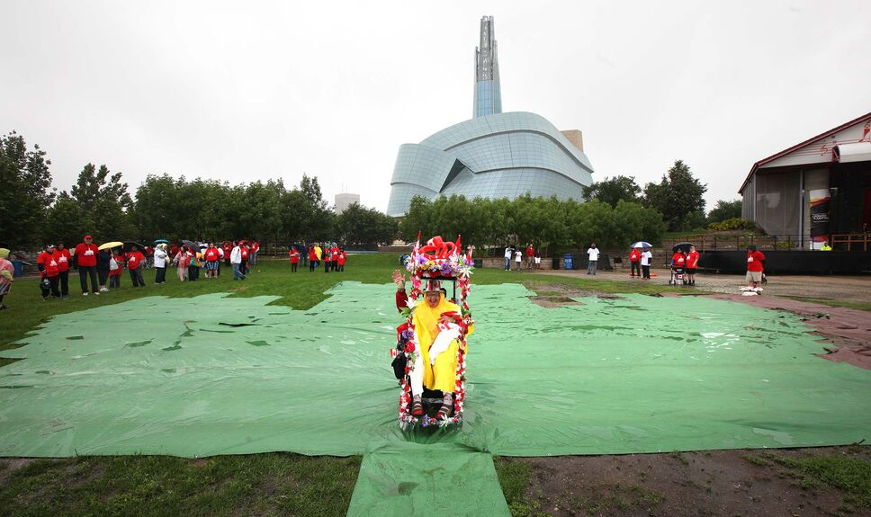 First up front and center, Olive Yaremko takes her place at the base of the maple leaf (outlined in green carpet) of the human flag. (Phil Hossack / Winnipeg Free Press)