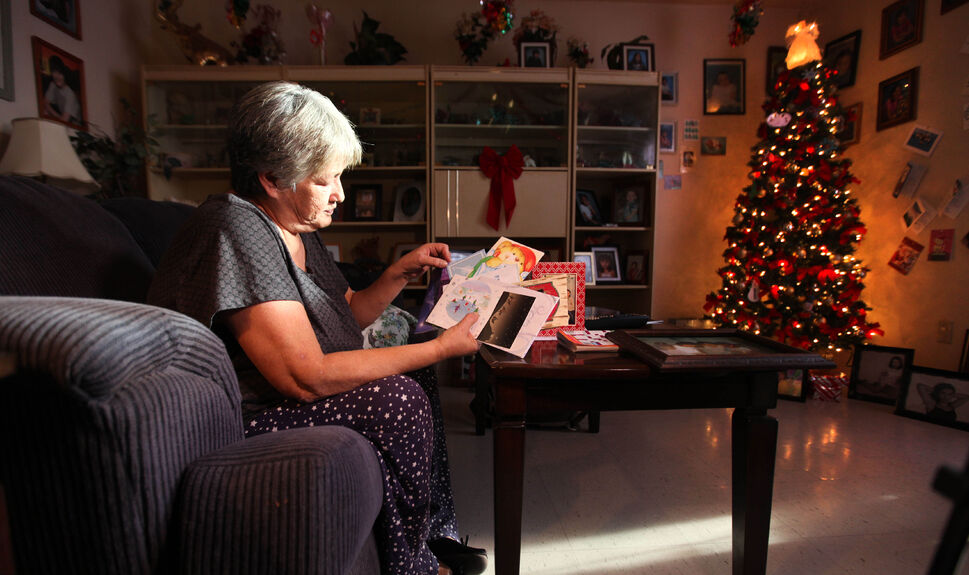 A glowing angel sits atop a brightly lit Christmas tree in the corner of Thelma Favel's living room. With a stack of cards and letters in her hand and more on the wall from well-wishers across the nation, Thelma Favel, Tina Fontaine's great-grandmother, is still stricken with grief and sadness as she and her family face their first Christmas without Tina. But in the midst of her grief, there appears a glimmer of hope after the outpouring of support and donations came in over the holidays for Tina and Faron Hall.   (Ruth Bonneville / Winnipeg Free Press  )